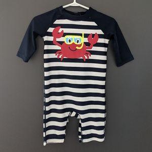 Navy blue and white striped crab print rash guard